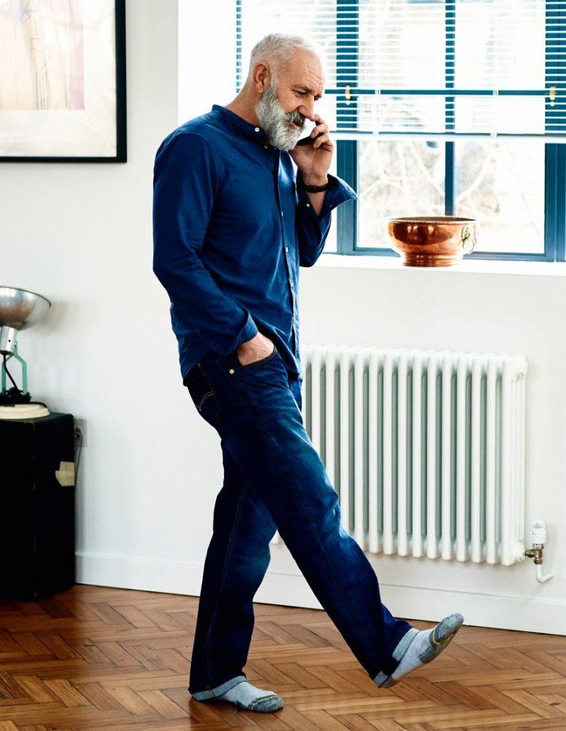 Man in socks, talking on phone